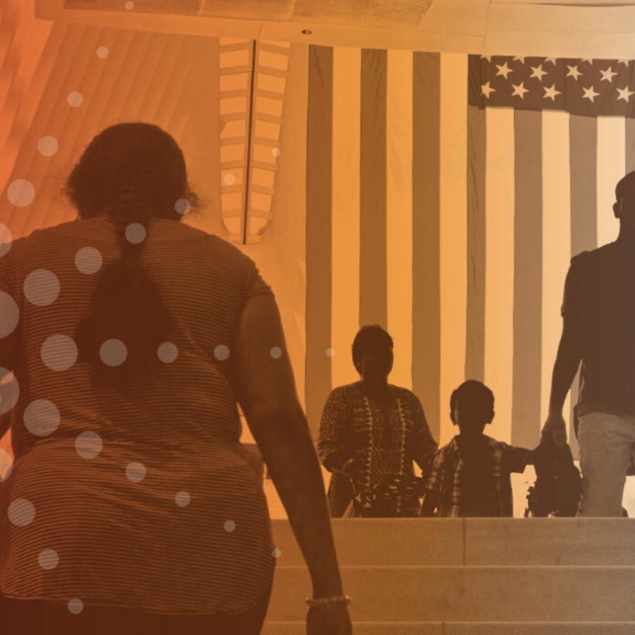 people-walking-under-american-flag